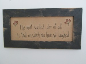 "15""x71/2"" framed stitchery  Price: $29.00"