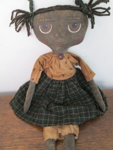 "17"" Urleen has big eyes! Her pony tails are tied with homespun which matches her skirt. $38.00"