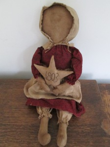 "18"" Sarah is holding her first piece of handwork - a star on which she's stitched ""1803"" and she's very proud of it. $39.00"