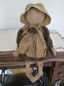 "17"" Abigail is weighted to sit. Her apron and prairie bonnet are coordinated to match her dress. $48.00"