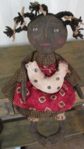 """18"""" Maybelle loves her pet chicken, Nugget.  She has sculpted toes and is weighted to sit anywhere.  $46.00"""