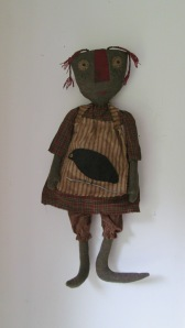 "24"" Emma is made to hang but can also sit.  $46.00"