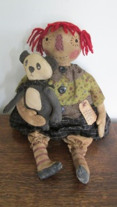 """Annie is 18"""" tall but has a big bottom and is weighted heavily to sit, so she looks shorter.  She loves her handmade panda and has a grungy tag attached with a rusty safety pin that says """"Old Toys"""".  Lots of detail!  $68.00"""