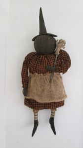 "Ella the witch can hang or sit. She's a big girl and is 33"" tall to the tip of her hat. $58.00"