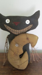 Kat's moon is attached and wrapped with a rusty star garland. He is heavily weighted to stand alone. $34.00