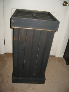 "Wastebasket is  25"" H x 15"" W.  Rim comes off to keep 13 gallon trash bag securely in place.  $52.00"