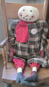 "Mrs. Winterberry is 26"" tall and weighted to sit anywhere. She is made of painted muslin and her clothes are flannel. She made herself a snowman pin for her dress! Her painted boots have red laces and she has red painted mittens. $58.00"