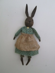 """17"""" Babette can hang or sit.  Made of painted, sanded, stained and baked muslin, she wears a tea-dyed vintage handkerchief for her apron.  $39.00"""