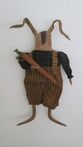 "Roscoe Rabbit is 20"" tall and can hang or sit. He is pretty dirty from being out in his garden digging carrots! $38.00"